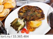 Купить «Cabeza de cordero - spanish dish. Lamb head with artichoke, tomatoes and potatoes», фото № 33365484, снято 9 апреля 2020 г. (c) Яков Филимонов / Фотобанк Лори