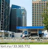 Abu Dhabi, UAE - March 31. 2019. Adnos - gas station with oil change. Редакционное фото, фотограф Володина Ольга / Фотобанк Лори