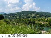 Купить «Rural landscape with mountains and houses in Zabljak Municipality, Montenegro», фото № 33366096, снято 14 июня 2019 г. (c) Володина Ольга / Фотобанк Лори