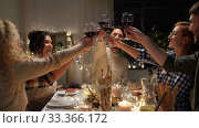 Купить «happy friends drinking red wine at christmas party», видеоролик № 33366172, снято 9 февраля 2020 г. (c) Syda Productions / Фотобанк Лори