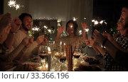 Купить «happy friends having christmas dinner at home», видеоролик № 33366196, снято 9 февраля 2020 г. (c) Syda Productions / Фотобанк Лори