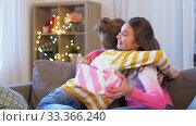 Купить «teenage girl giving present to her friend at home», видеоролик № 33366240, снято 18 января 2020 г. (c) Syda Productions / Фотобанк Лори