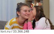 Купить «happy teenage girls gossiping at home», видеоролик № 33366248, снято 18 января 2020 г. (c) Syda Productions / Фотобанк Лори