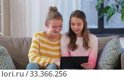 Купить «happy teenage girls with tablet computer at home», видеоролик № 33366256, снято 18 января 2020 г. (c) Syda Productions / Фотобанк Лори