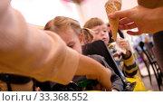 Купить «Little girl in small car with anonymous parents», видеоролик № 33368552, снято 11 марта 2020 г. (c) Ekaterina Demidova / Фотобанк Лори
