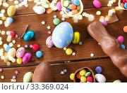 Купить «chocolate eggs, easter bunny and candies on wood», фото № 33369024, снято 22 марта 2018 г. (c) Syda Productions / Фотобанк Лори