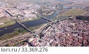 Купить «Aerial panoramic view of modern cityscape of Badajoz with Guadiana river, Spain», видеоролик № 33369276, снято 22 апреля 2019 г. (c) Яков Филимонов / Фотобанк Лори