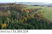 Купить «Autumn views of the Czech Republic. Aerial view of church Panny Marie.», видеоролик № 33369324, снято 17 октября 2019 г. (c) Яков Филимонов / Фотобанк Лори