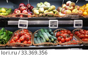 Купить «Colorful market counter with large assortment of fresh fruits and vegetables for sale», видеоролик № 33369356, снято 7 ноября 2019 г. (c) Яков Филимонов / Фотобанк Лори