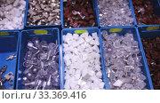 Купить «Boxes with furniture accessories in a hardware store», видеоролик № 33369416, снято 5 июля 2020 г. (c) Яков Филимонов / Фотобанк Лори