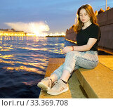Portrait of a girl on the background of the evening city on the waterfront . Saint Petersburg, Neva river. Стоковое фото, фотограф Алексей Маринченко / Фотобанк Лори