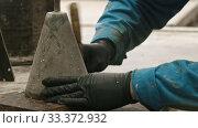 Купить «Concrete industry - a man working with a chisel», видеоролик № 33372932, снято 5 июня 2020 г. (c) Константин Шишкин / Фотобанк Лори