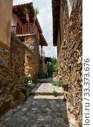 Купить «Narrow paved street of old Kakopetria. Nicosia District. Cyprus», фото № 33373676, снято 11 июня 2018 г. (c) Serg Zastavkin / Фотобанк Лори