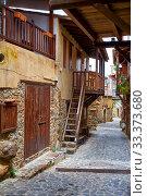 Купить «The narrow mediaeval street of old Kakopetria. Nicosia District. Cyprus», фото № 33373680, снято 11 июня 2018 г. (c) Serg Zastavkin / Фотобанк Лори