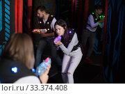 Купить «Girl on lasertag arena», фото № 33374408, снято 25 апреля 2018 г. (c) Яков Филимонов / Фотобанк Лори