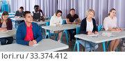 Купить «Adult students listening in classroom», фото № 33374412, снято 8 мая 2018 г. (c) Яков Филимонов / Фотобанк Лори