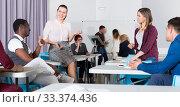 Купить «Students enjoying free time in class», фото № 33374436, снято 8 мая 2018 г. (c) Яков Филимонов / Фотобанк Лори