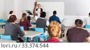 Купить «Students with teacher studying in classroom», фото № 33374544, снято 8 мая 2018 г. (c) Яков Филимонов / Фотобанк Лори