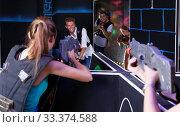 Купить «Teams of laser tag game girls and guys playing emotionally opposite each other», фото № 33374588, снято 27 августа 2018 г. (c) Яков Филимонов / Фотобанк Лори