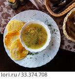 Купить «Belarusian Machanka with pancakes», фото № 33374708, снято 30 марта 2020 г. (c) Яков Филимонов / Фотобанк Лори