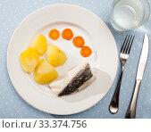 Codfish prepared on steam with potatoes and carrots at plate. Стоковое фото, фотограф Яков Филимонов / Фотобанк Лори
