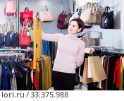 Купить «Woman treats stylish blouse», фото № 33375988, снято 7 февраля 2017 г. (c) Яков Филимонов / Фотобанк Лори