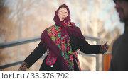 Russian folklore - cheerful woman in a beautiful scarf is dancing in the park. Стоковое видео, видеограф Константин Шишкин / Фотобанк Лори