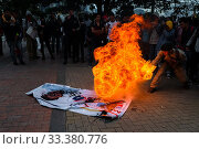 Купить «A student of the Universidad Nacional de Colombia spits fire during a protest march against government's policies and corruption within the public educational...», фото № 33380776, снято 24 октября 2019 г. (c) age Fotostock / Фотобанк Лори