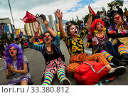 Купить «Students of the Universidad Nacional de Colombia, wearing clown costumes, take part in a protest march against government's policies and corruption within...», фото № 33380812, снято 24 октября 2019 г. (c) age Fotostock / Фотобанк Лори