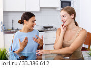 Купить «Two friendly girls having emotional conversation», фото № 33386612, снято 29 августа 2018 г. (c) Яков Филимонов / Фотобанк Лори