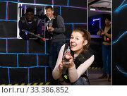 Adult girl aiming laser gun during lasertag game. Стоковое фото, фотограф Яков Филимонов / Фотобанк Лори
