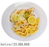Купить «Fried sepia with green sauce, fries and lemon», фото № 33386868, снято 4 апреля 2020 г. (c) Яков Филимонов / Фотобанк Лори