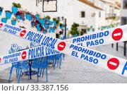 Купить «Mijas quarantined street caused by COVID-19. Spain», фото № 33387156, снято 17 декабря 2019 г. (c) Alexander Tihonovs / Фотобанк Лори