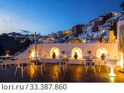 Купить «City view from cafe terrace in the evening. Fira, Santorini, Greece», фото № 33387860, снято 8 июня 2017 г. (c) Наталья Волкова / Фотобанк Лори