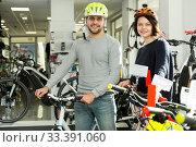 man and woman in helmet standing with bike. Стоковое фото, фотограф Яков Филимонов / Фотобанк Лори