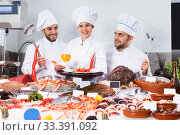 Купить «chefs offering fresh marine products for tasting», фото № 33391092, снято 26 января 2018 г. (c) Яков Филимонов / Фотобанк Лори