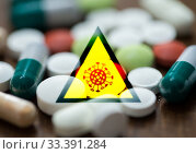 Купить «coronavirus caution sign and drugs in pills», фото № 33391284, снято 9 июня 2016 г. (c) Syda Productions / Фотобанк Лори