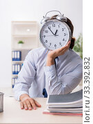 Купить «Young male businessman employee unhappy with excessive work», фото № 33392832, снято 10 сентября 2019 г. (c) Elnur / Фотобанк Лори