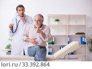 Купить «Young male doctor and old patient in antismoking concept», фото № 33392864, снято 9 сентября 2019 г. (c) Elnur / Фотобанк Лори
