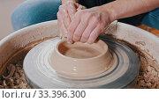 Купить «Pottery - master with wet hands begining to pull the clay up», фото № 33396300, снято 9 июля 2020 г. (c) Константин Шишкин / Фотобанк Лори