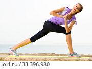 Woman practising yoga poses standing on beach. Стоковое фото, фотограф Яков Филимонов / Фотобанк Лори