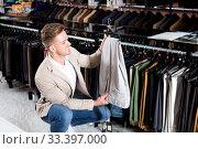 Купить «Man choosing on new trousers», фото № 33397000, снято 4 апреля 2020 г. (c) Яков Филимонов / Фотобанк Лори