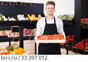 Купить «Male seller in grocery shop», фото № 33397012, снято 23 ноября 2016 г. (c) Яков Филимонов / Фотобанк Лори