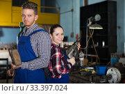 Купить «Man with female in workshop.», фото № 33397024, снято 10 октября 2017 г. (c) Яков Филимонов / Фотобанк Лори