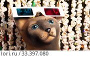 Купить «Cat figurine in 3D glasses. Defocused dynamic background of garlands from popcorn and golden sparkling tinsel. Garlands of popcorn for movie news. Invitation to watch movie. 4K video», видеоролик № 33397080, снято 9 апреля 2020 г. (c) Dmitry Domashenko / Фотобанк Лори