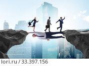 Купить «Businessman acting as a bridge in support concept», фото № 33397156, снято 3 апреля 2020 г. (c) Elnur / Фотобанк Лори