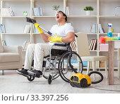 Купить «Disabled man with vacuum cleaner at home», фото № 33397256, снято 7 апреля 2017 г. (c) Elnur / Фотобанк Лори