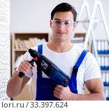 Купить «Repairman working with drilling drill perforator», фото № 33397624, снято 9 декабря 2016 г. (c) Elnur / Фотобанк Лори
