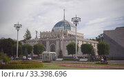 Купить «People walk in VDNH park. Pavilion 11 Kazakhstan, flowerbed, summer cloudy day», видеоролик № 33398696, снято 6 июля 2019 г. (c) Ирина Мойсеева / Фотобанк Лори
