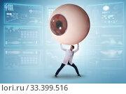 Купить «Doctor examining giant eye in medical concept», фото № 33399516, снято 9 апреля 2020 г. (c) Elnur / Фотобанк Лори